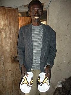 Rwandan_farmer_new_shoes